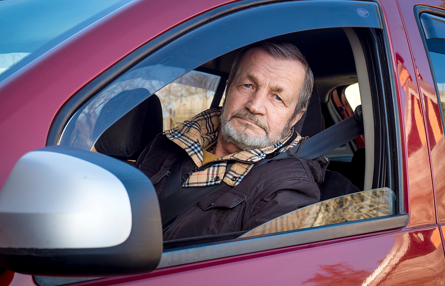 Old man driving with dementia