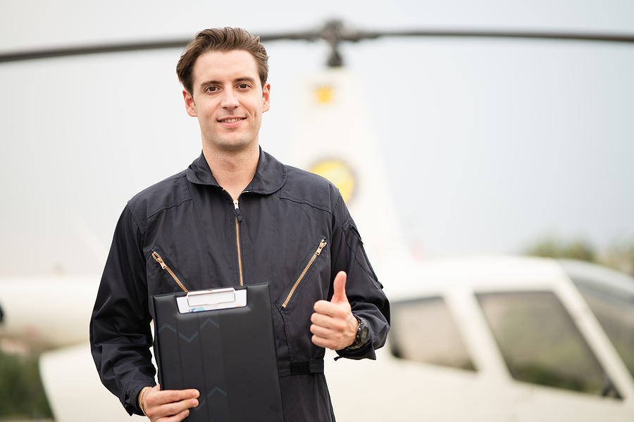 Young man taking helicopter training in Sydney