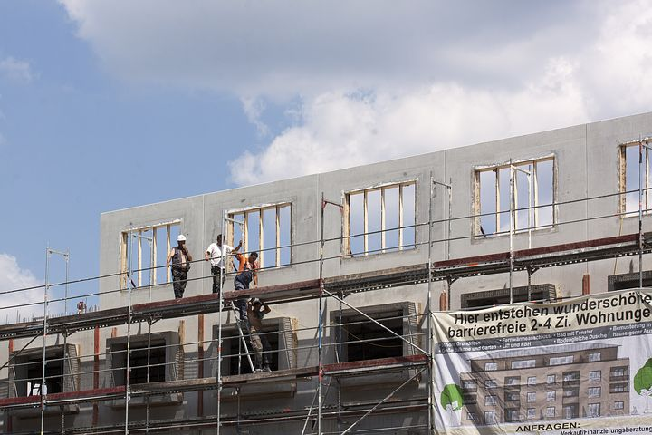 Workers while on scaffold
